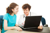 Teen Medical - Reviewing Test Results — Stock Photo