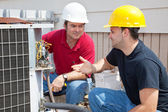 AC Technicians Discuss Problem — Stock Photo