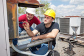 Apprentice Air Conditioning Repairman — Stock Photo