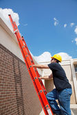 Construction Worker Climbs to Roof — Stock Photo