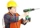 Vrouwelijke bouwvakker boren — Stockfoto