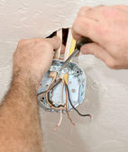 Electrician Attaching Ceiling Box — Stock Photo