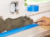 Tiler Applies Mortar — Stock Photo
