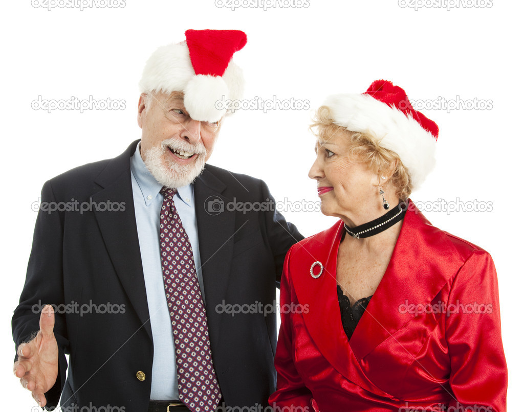 Tipsy senior man embarasses his wife at a Christmas party.  Isolated. — Stock Photo #6511152