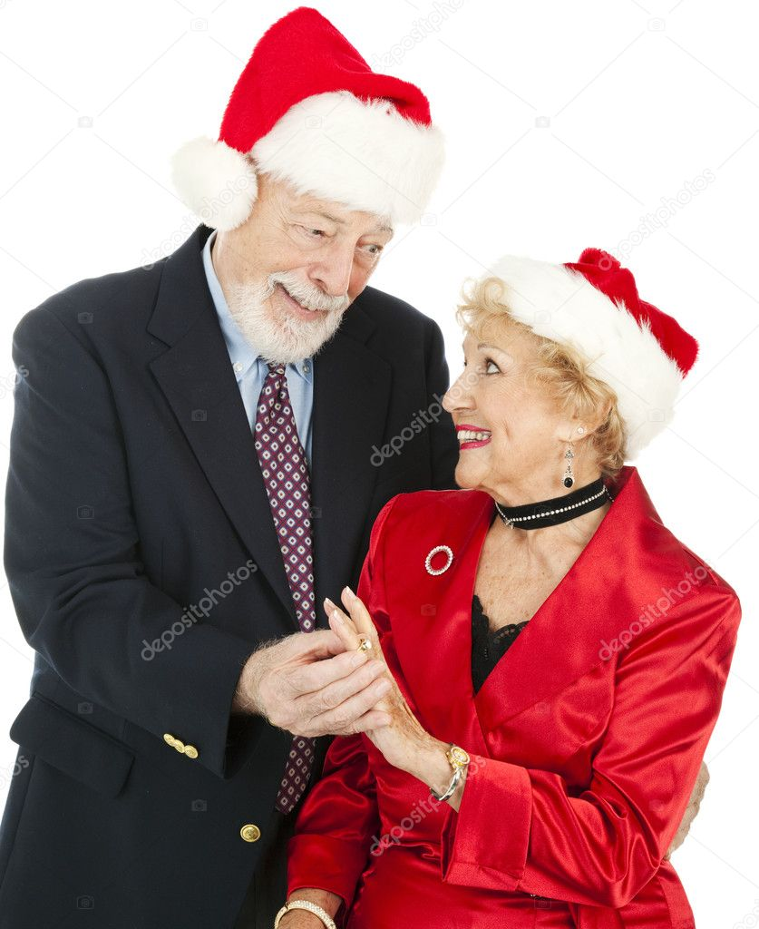 Senior man giving his wife a diamond and pearl ring for Christmas.  Isolated on white. — Stock Photo #6511178