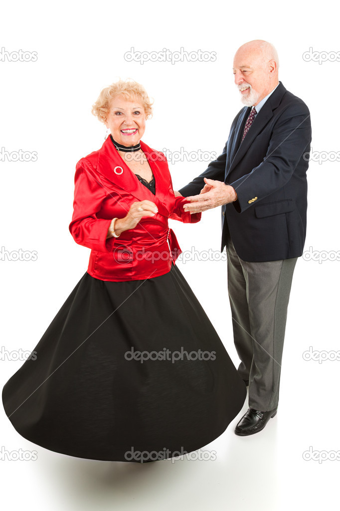 Beautiful senior lady spinning as she dances with her husband. Full body isolated on white.    Stock Photo #6511180