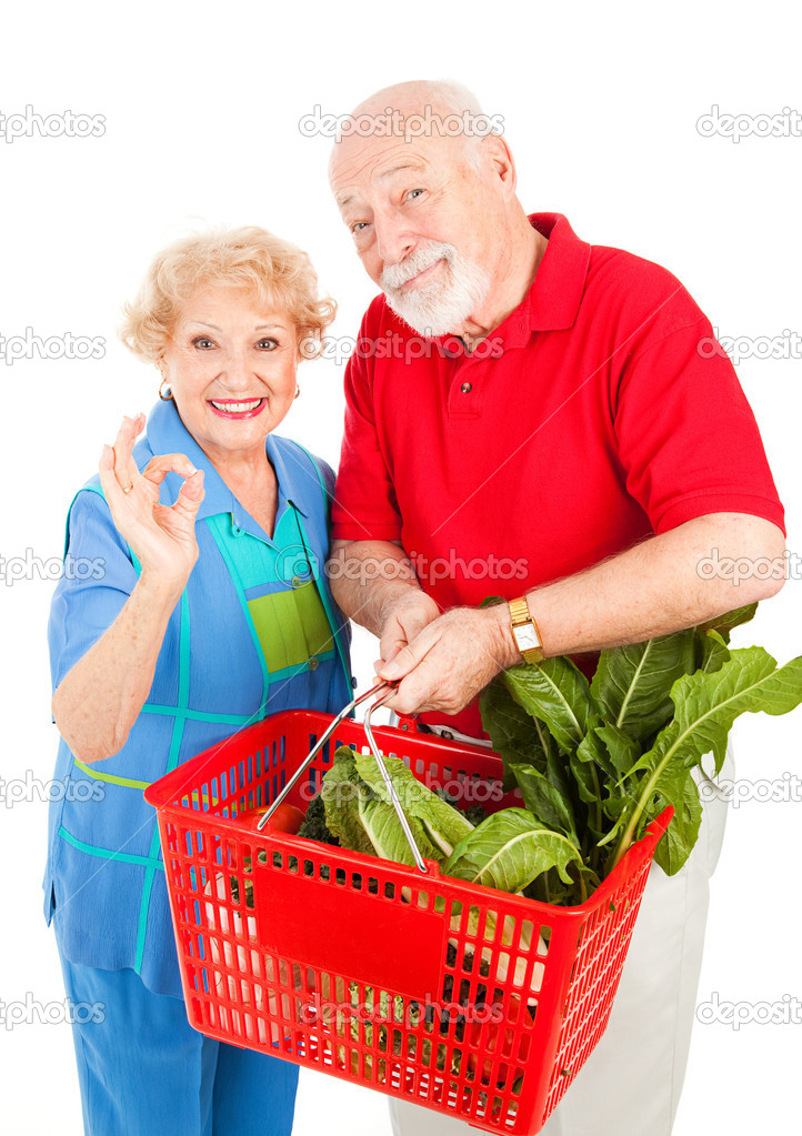 Senior couple shopping for organic produce and giving the okay sign.  Isolated on white.  — Stock Photo #6511237