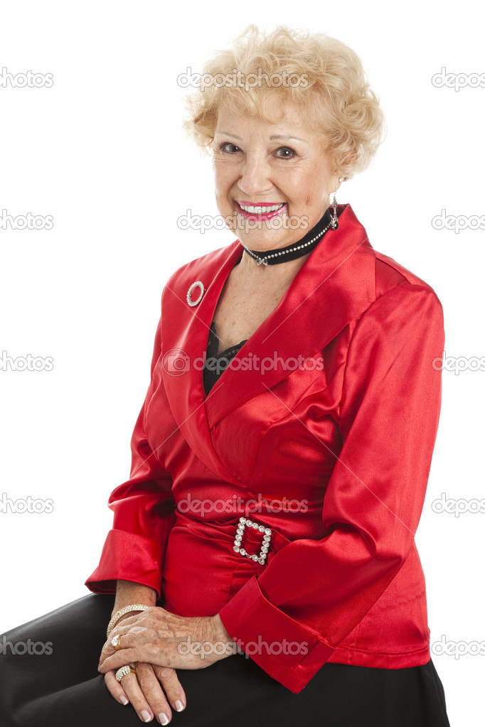 Portrait of a beautiful senior woman dressed up for the holidays.  Isolated on white.  Stock Photo #6511287