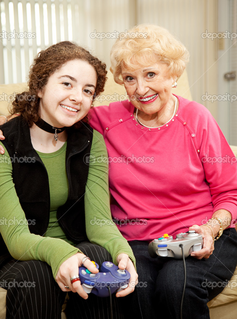 Grandmother and teen granddaughter bonding by playing video games together.  — Stock Photo #6511788