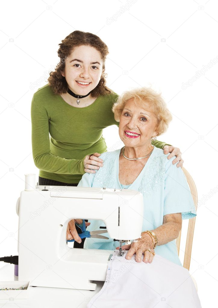 Teenage girl and her grandmother working on a sewing project together.  Isolated on white. — Stock Photo #6511829