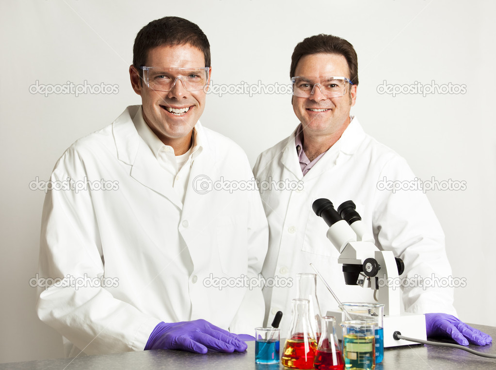 Happy, smiling scientific colleagues in the laboratory.   — Stock Photo #6515545