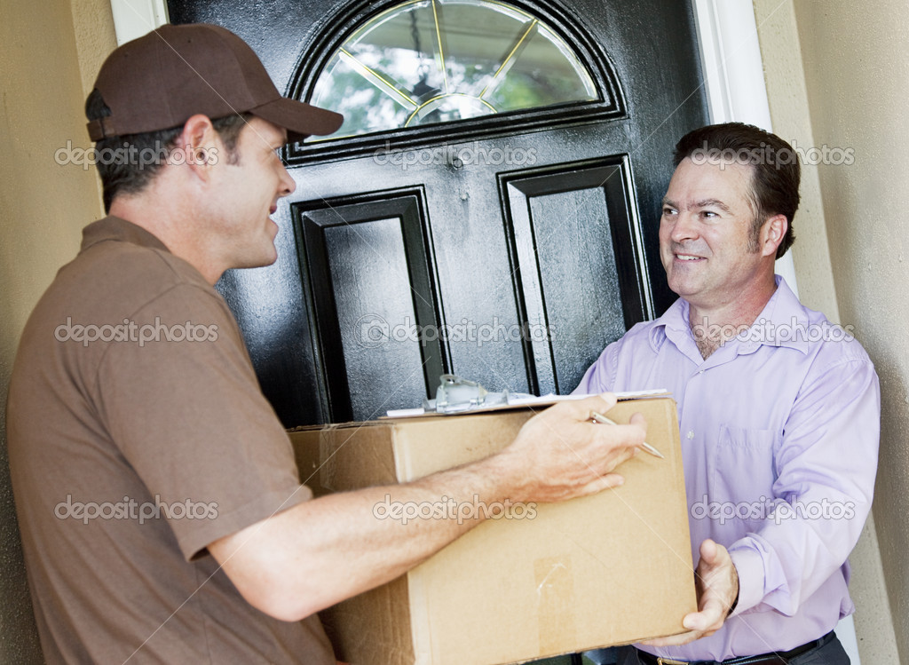 Man receiving a package delivery from a courier at his home.   — Stock Photo #6515629