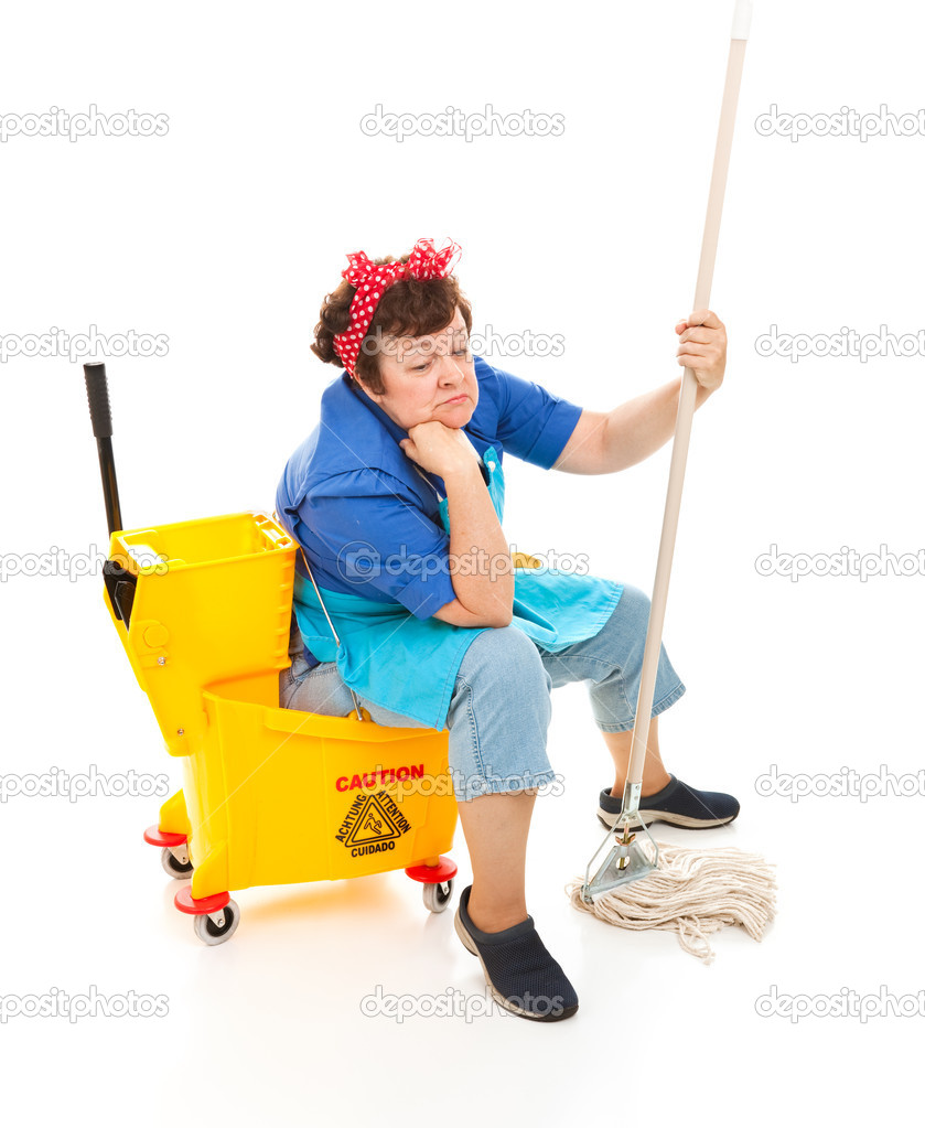 Depressed maid sitting in her bucket and holding her mop, with a sad expression on her face.  Full body isolated. — Stock Photo #6516235