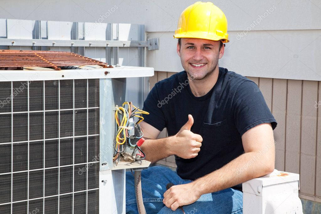Air conditioning repairman working on a compressor and giving a thumbsup. — Stock Photo #6516734
