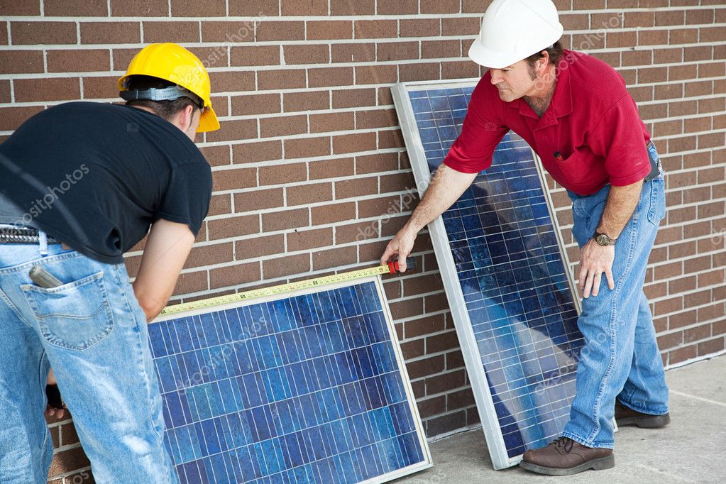 Electricians measuring solar panels they are about to install.   — Stock Photo #6516760