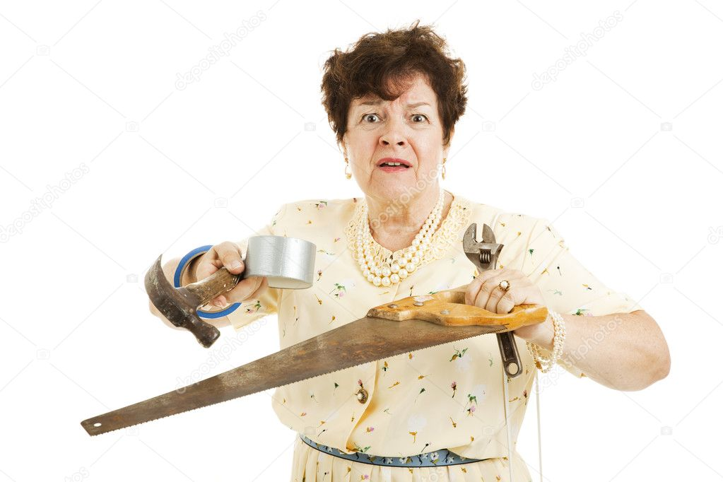 Older lady holding tools.  She is confused and overwhelmed by home improvement project.  Isolated on white.   — Stock Photo #6517076