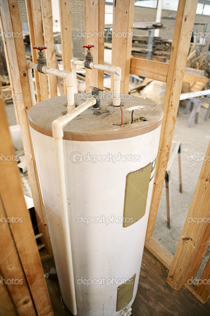 Construction site with hot water heater installed.  Focus on center top of water heater.   — Stock Photo #6517355