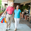 Shopping Seniors - Carrying Her Bags - Stock Photo