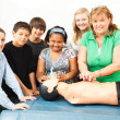 Teacher with CPR Class and Dummy — Stock Photo