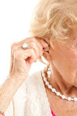 Inserting Hearing Aid — Stock Photo