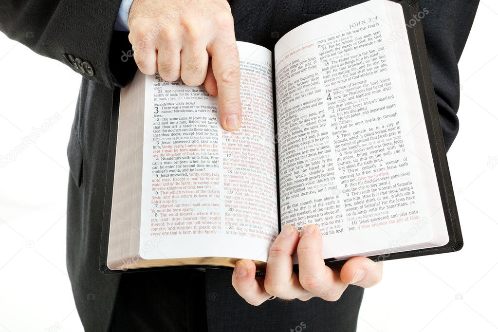 Businessman or minister holding a bible open to John 3:16.  White background. — Foto Stock #6533125