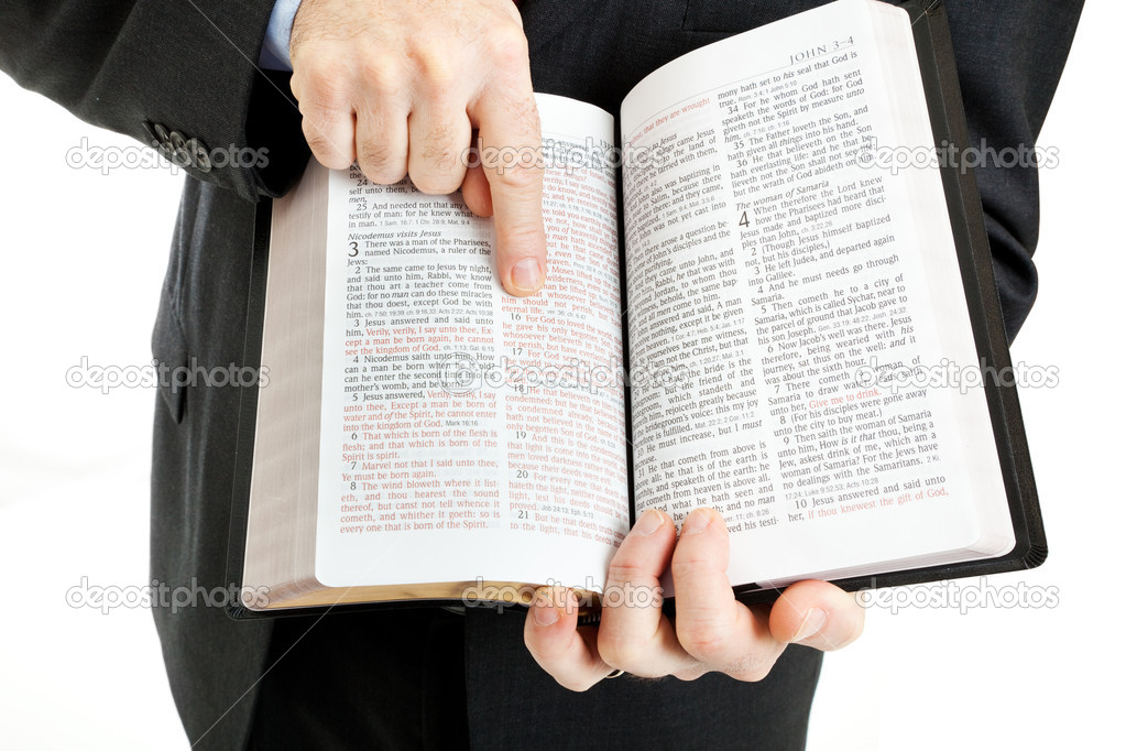 Businessman or minister holding a bible open to John 3:16.  White background. — Lizenzfreies Foto #6533125