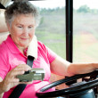 Stock Photo: RV Senior - WomUsing GPS
