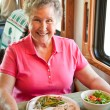 Royalty-Free Stock Photo: RV Senior Woman Dining