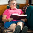 RV Senior Woman Reading - Stock Photo