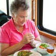 Stock Photo: RV Senior WomSays Grace