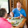 Royalty-Free Stock Photo: RV Seniors - Great Dinner Honey