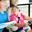 RV Seniors Reading Map - Stock Photo