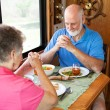 Stock Photo: Senior Couple - Mealtime Prayer