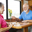 Seniors Play Backgammon — Stock Photo #6555376