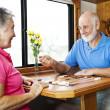 Seniors Play Backgammon — Stock Photo