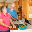 Stock Photo: Seniors RV - Romance in Kitchen