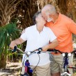 Bicycling Seniors Kiss — Stock Photo