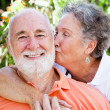 Senior Couple - Affectionate Kiss — Stock Photo