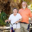 Stock Photo: Senior Couple with Bikes