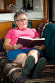 RV Senior Woman Reading — Stock Photo