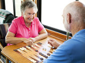 RV Seniors Play Backgammon — Stock Photo