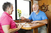 Seniors Play Backgammon — Stock Photo