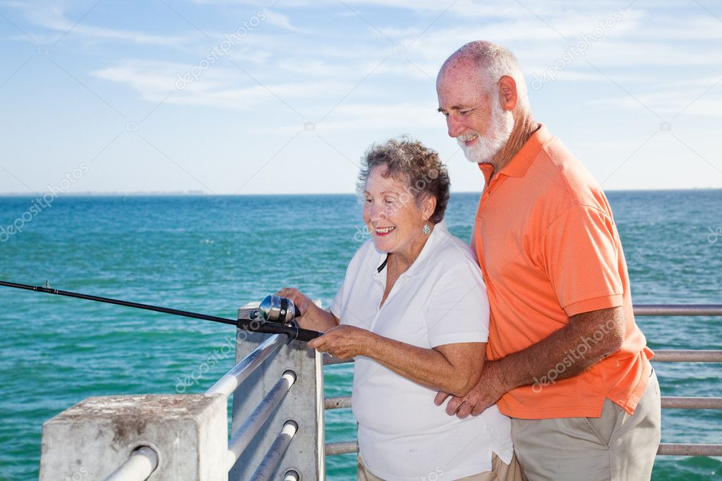 seniors fishing together stock photo lisafx 6555653