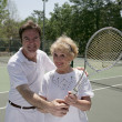 Active Senior With Tennis Pro — Stock Photo #6574623