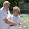 Active Seniors Play Tennis — Stock Photo