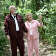 Active Seniors Walk in Woods — Stock Photo