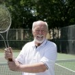 Senior Man Plays Tennis — 图库照片