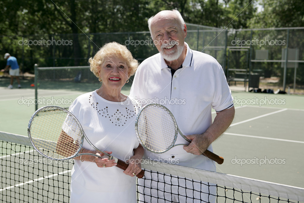An attractive senior couple ready to play tennis.   — Stock Photo #6574621