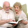 Senior Couple Reading Together — Stock Photo
