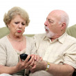 Seniors Fighting Over TV Remote — Stock Photo